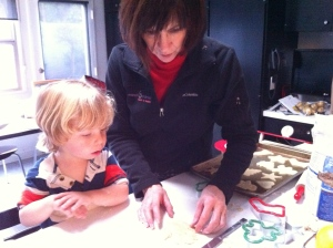 Gigi shows Q how to cut out a Christmas cookie...such fun!